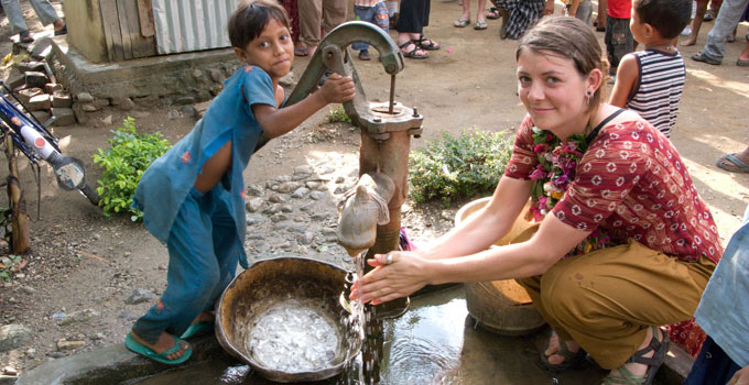 image of a woman and child in Peru with a well pump