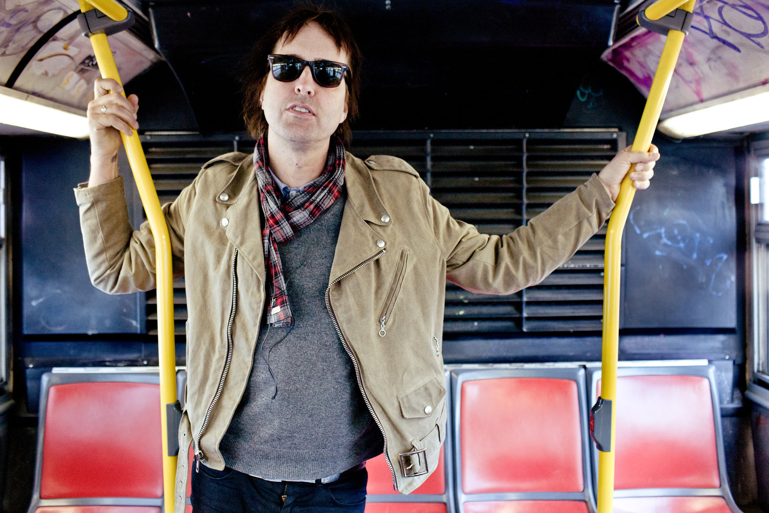 photo of Chuck Prophet on a bus looking cool
