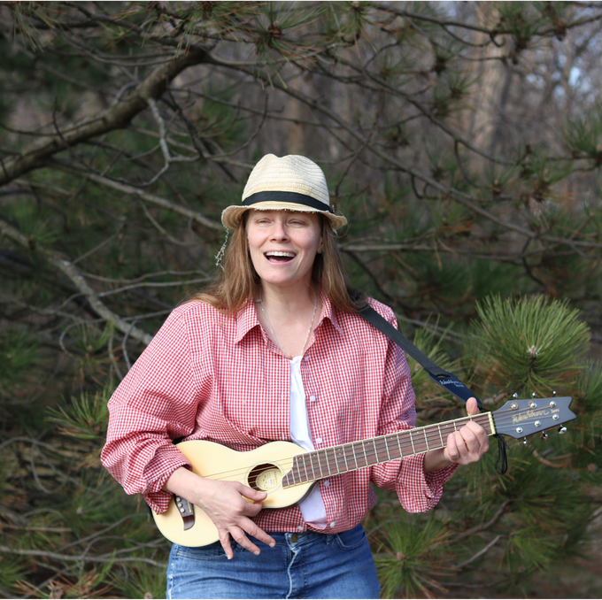 Barb Sorensen playing backpacker guitar