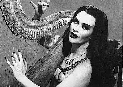 Lilly Munster on the Harp