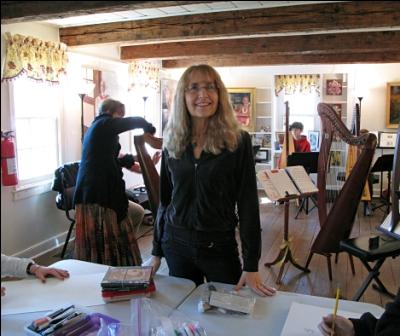 Susan Antin at the Farmstead class drawing harps