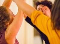 People in a group exploring creative movement together