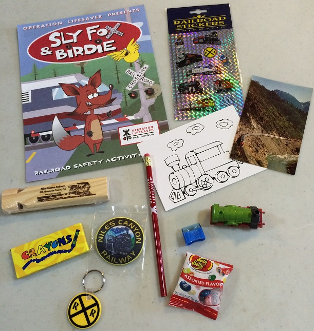 Wooden whistle, patch, zipper-pull, Activity book and more