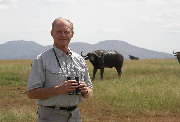 Dr. Sinclair standing in Serengeti
