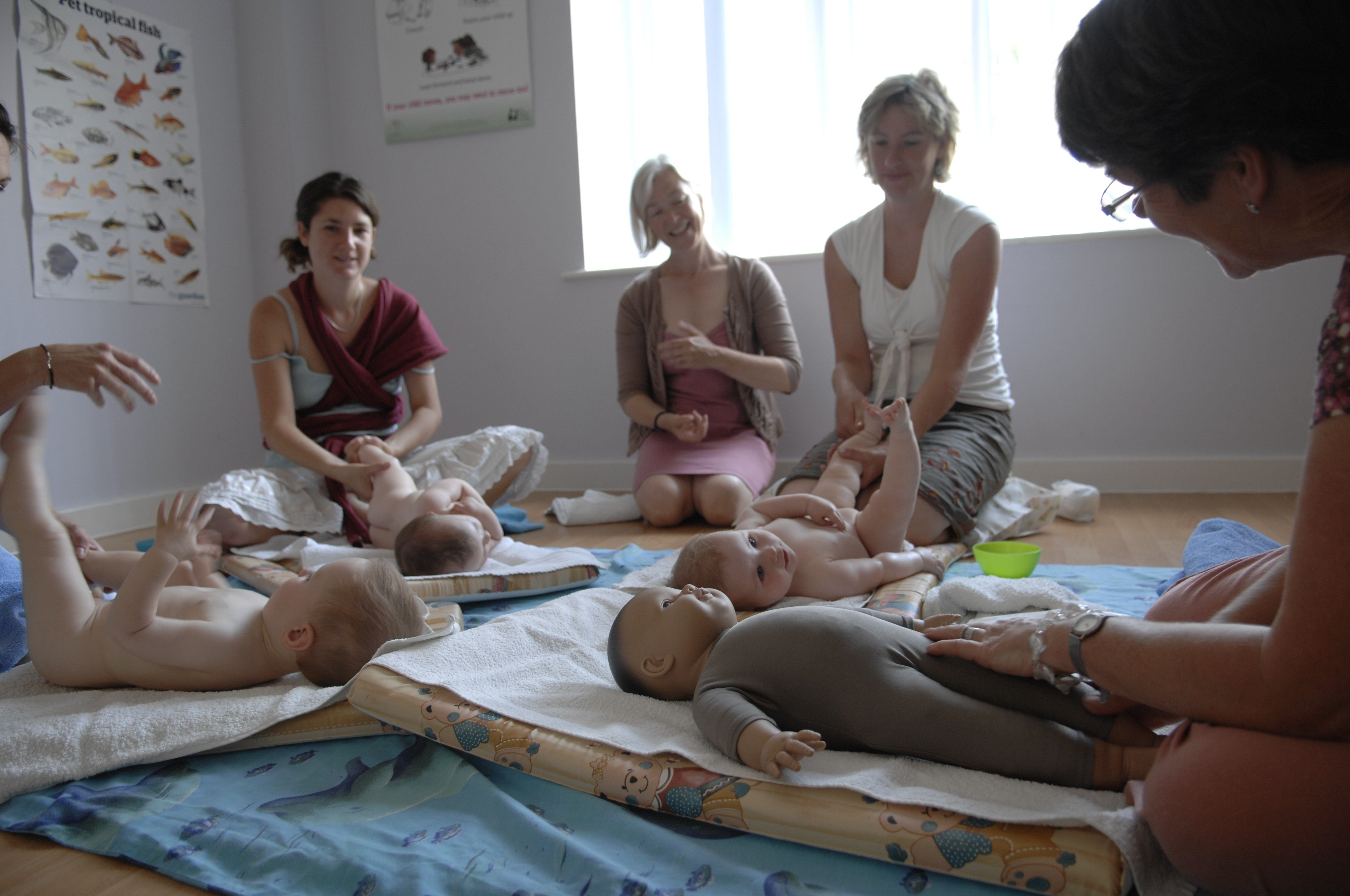 A group of mums learning baby massage from Sally Cranfield