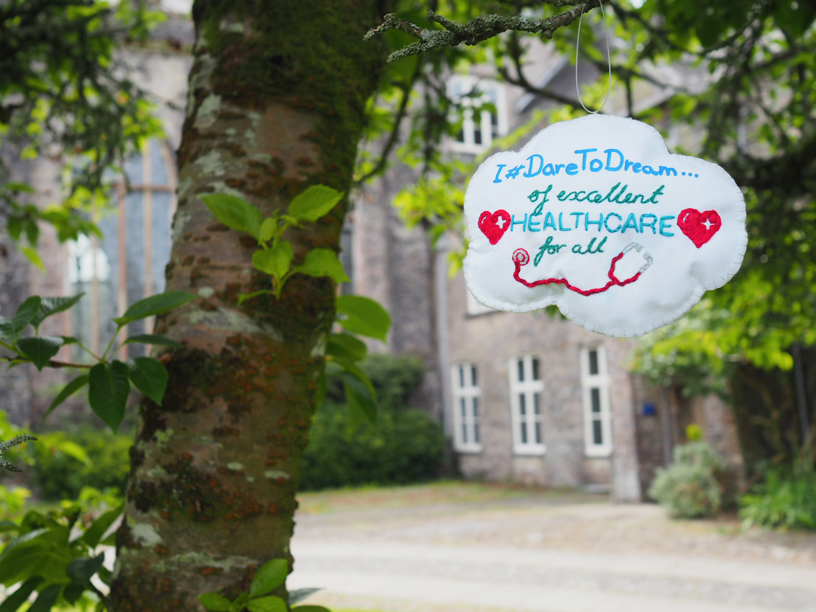 Handstitched cloud hanging outside Dartington Hall where the idea of the NHS was born...