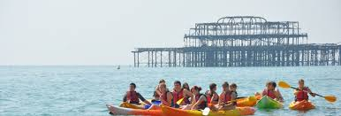 sea kayaks with the West Pier in the background
