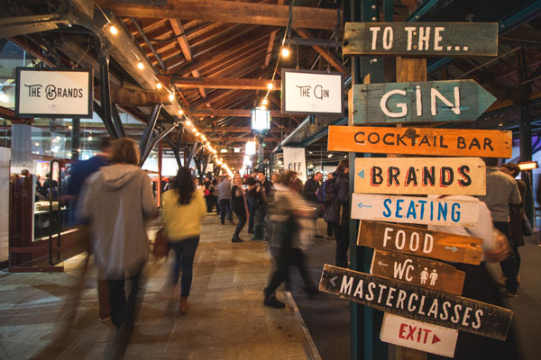 Sign pointing to all the features at Gin Festival