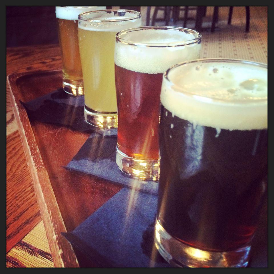 A sampling of Gino's four flagship beers: German Helles, Black Rye IPA, English IPA, and Belgian Witte