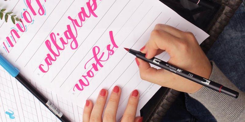 Calligraphy teacher using brush pens.