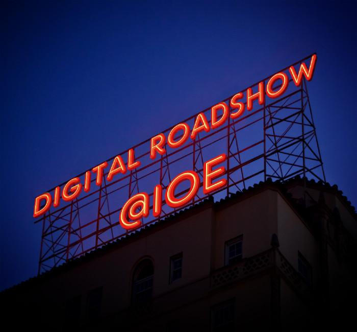 Billboard sign with words' IOE Digital Roadshow