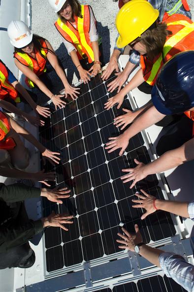 Hands in solar panel