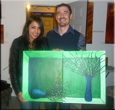 Couple holding their paintings