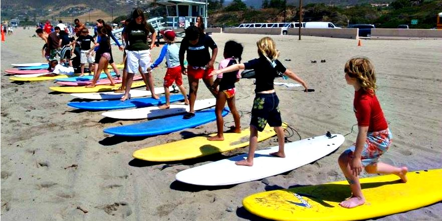 Campers on the beach at Aloha Beach Camp learning to surf