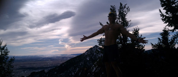 david running above boulder