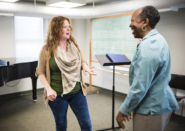 Jodi Burns instructs an adult voice student