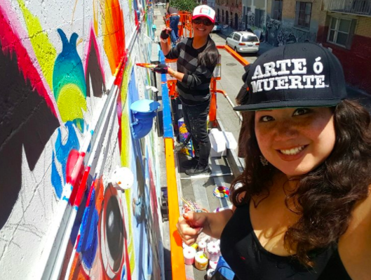 Elaine and Marina painting a mural in Hemlock Alley, San Francisco CA