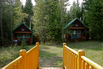 Cozy solar powered heritage cabins with wood burning stoves include 1 queen, 1 single and a private bathroom ensuite.