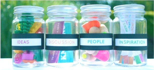 Image of glass jars with labels on saying ideas, discussion, people, inspiration