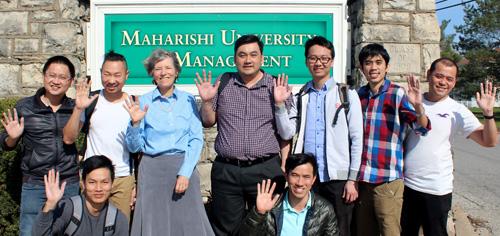 Vietnamese Computer Science graduate students with program director at Maharishi University of Management