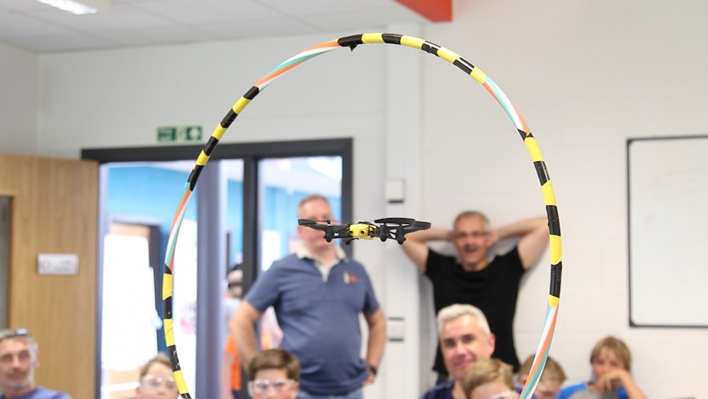 Drone flying through a hoop.