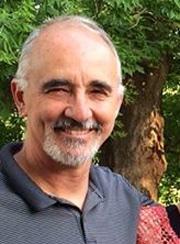Headshot of Tom Kuala