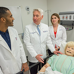 Dean Reed with Medical Students in the Sim Center
