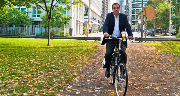 Dr. Penalosa riding a bike