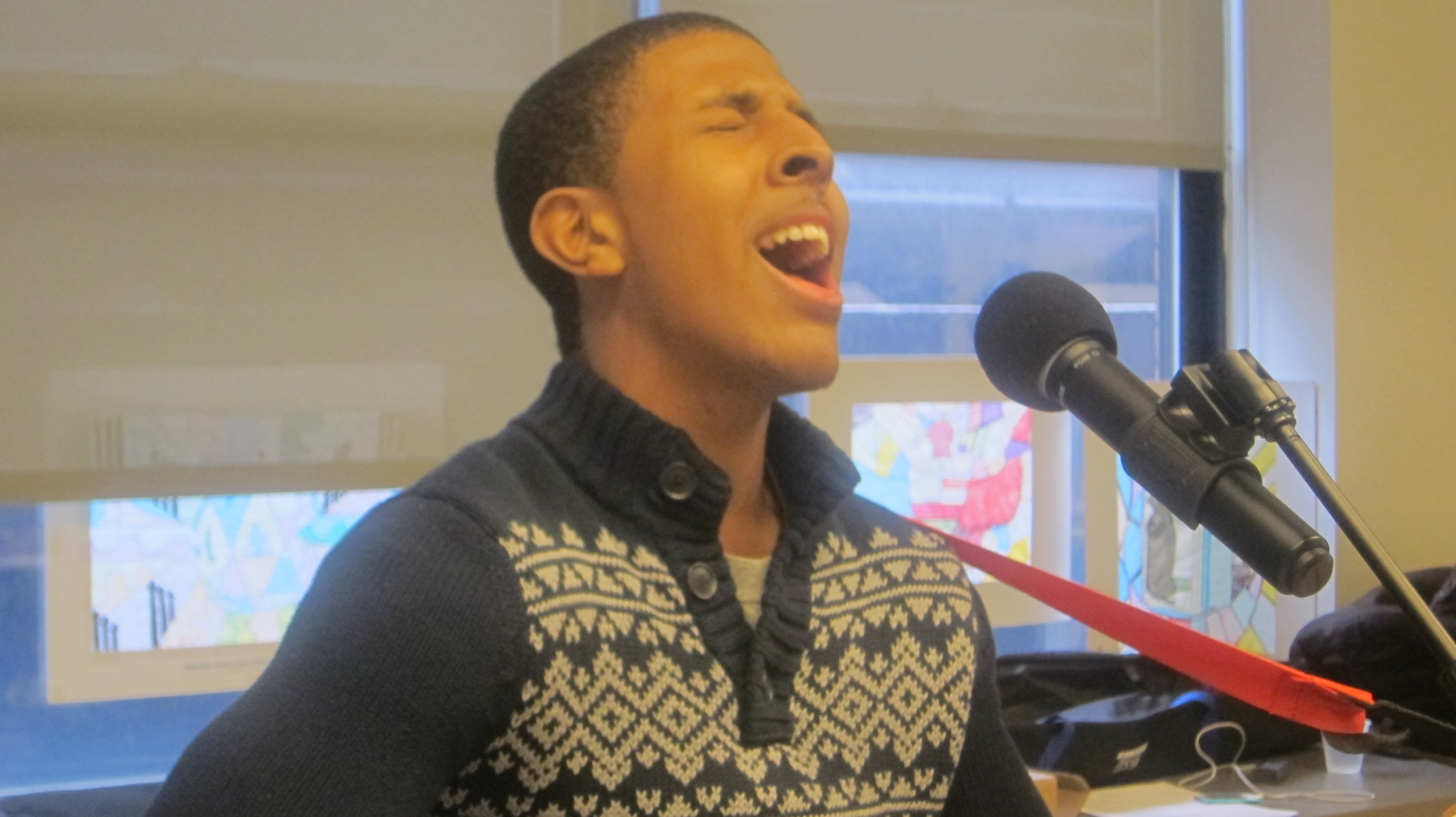 Anthony Cruz singing at The Fortune Musc Cafe