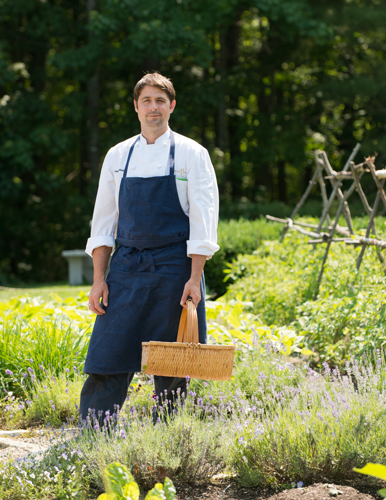 Chef Justin Walker in the Chef's Garden at Hidden Pond