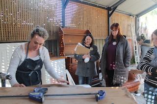Hayley Nicole demonstrating sanding timber