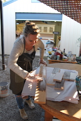 Hayley Nicole demonstrating stained timber