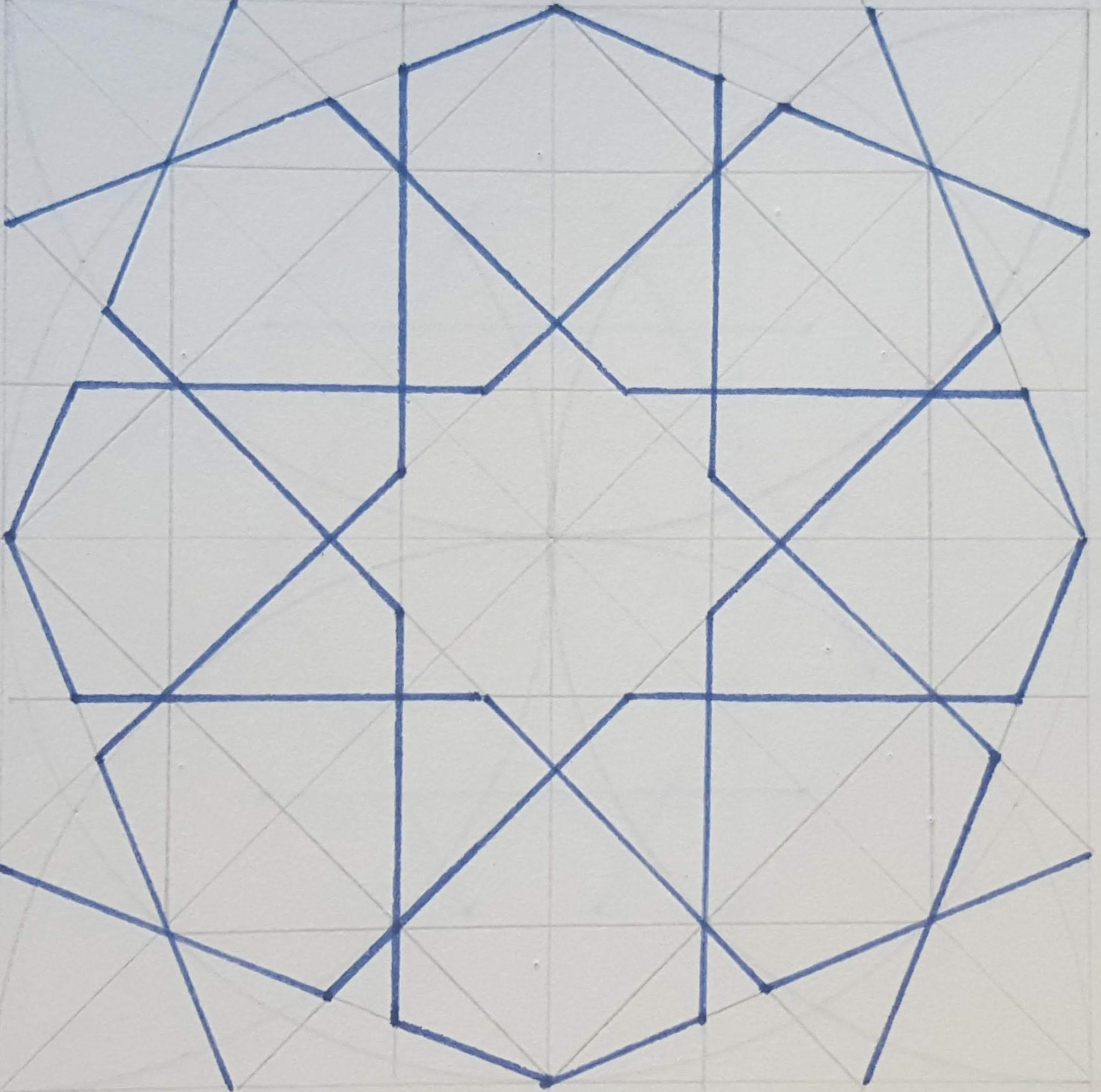 A pen drawing of a geometric pattern tile on a pencil grid, drawn with a compass and ruler.