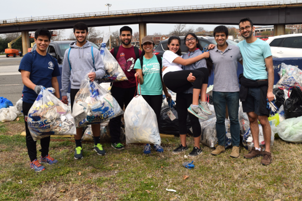Volunteers show off their hard work during a Potomac Conservancy cleanup at Kingman Island