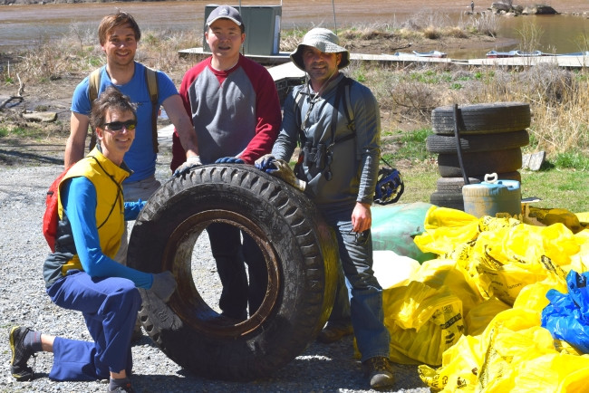 Cleanup volunteer with tire