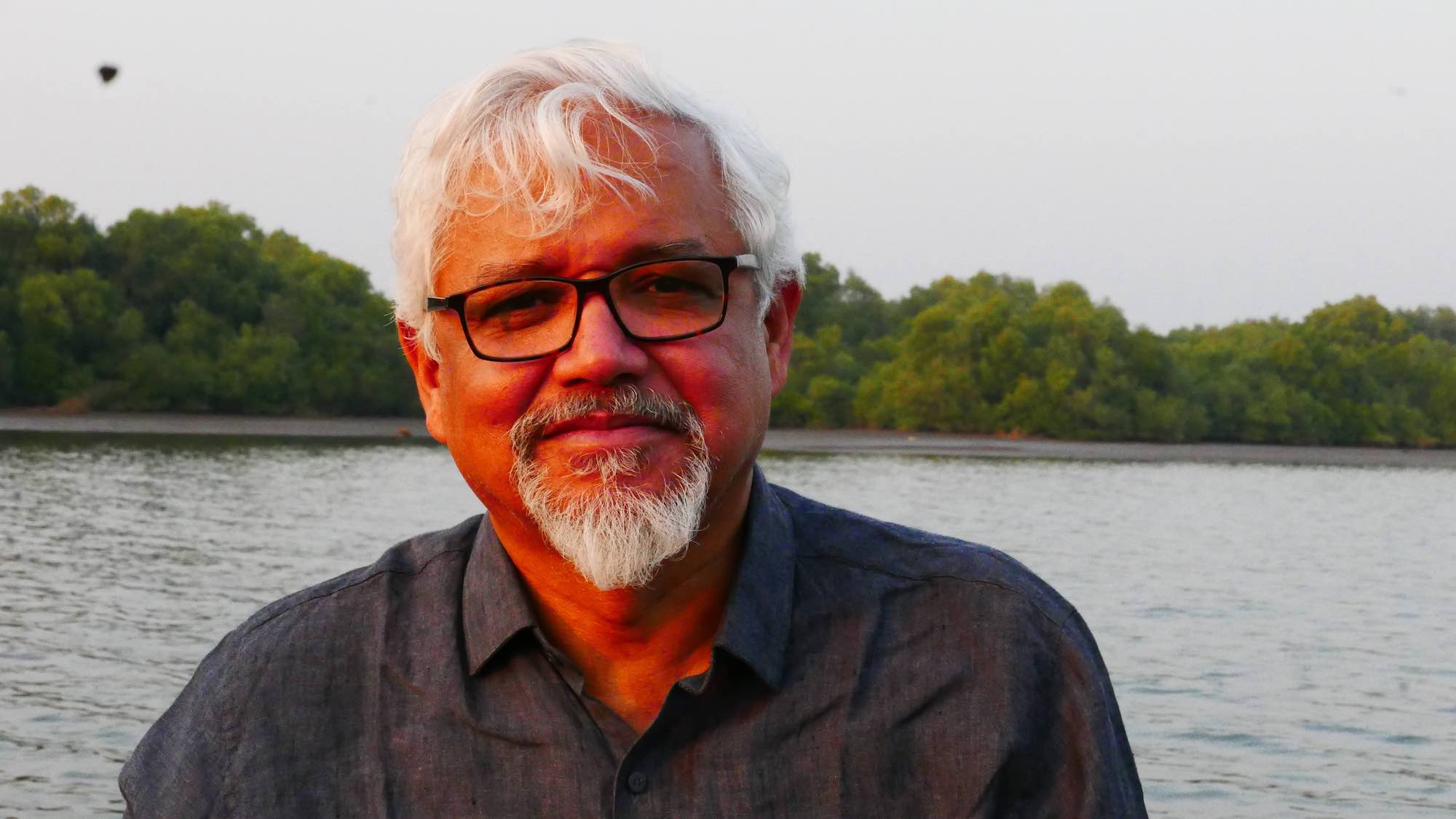 Photo of Dr. Ghosh at a lakeside