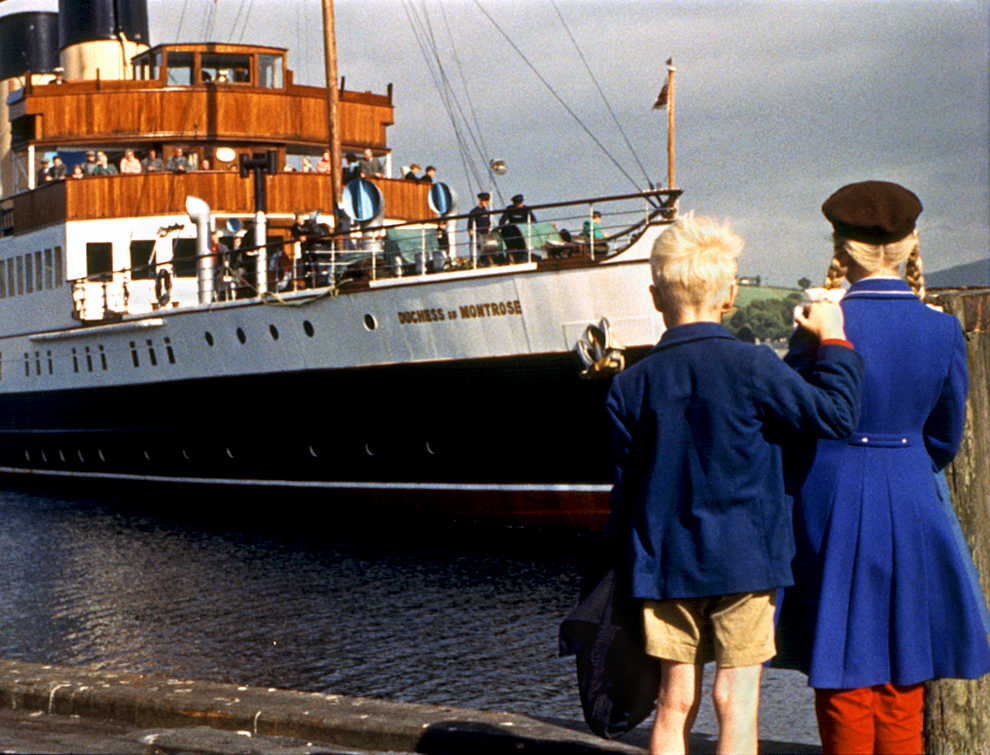 Image of a boat docking with a boy and girl in the foreground