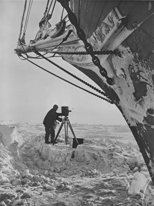 Photographer Frank Hurley with camera