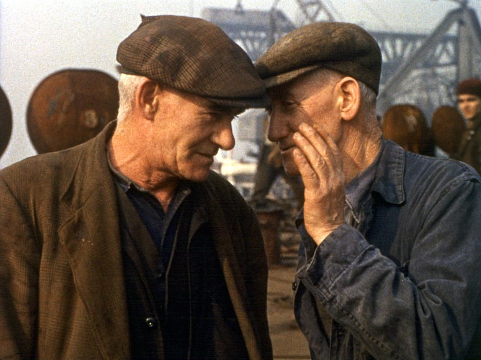Image of two shipyard workers talking to each other