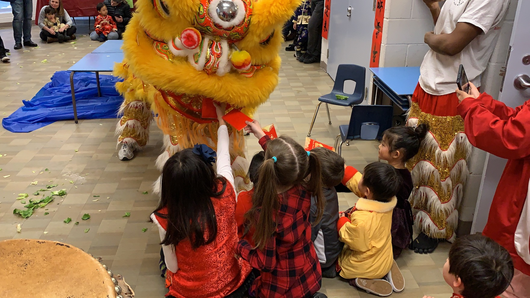 Giving lucky red pockets at the traditional lion dance