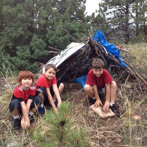 Kids building shelter