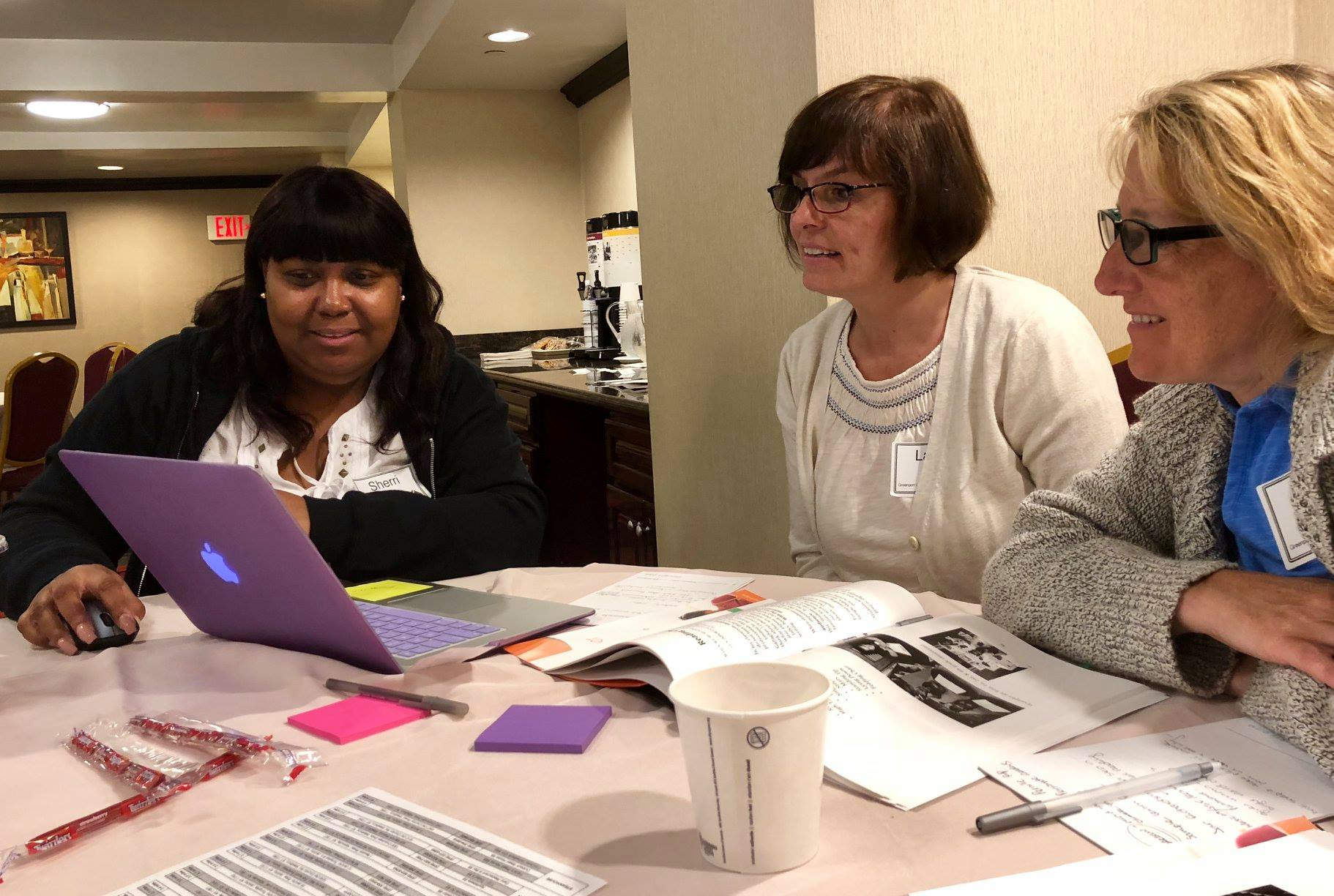 Literacy Workshop Attendees Collaborating