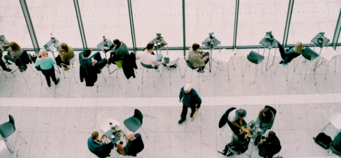 overhead image of people talking in a cafe