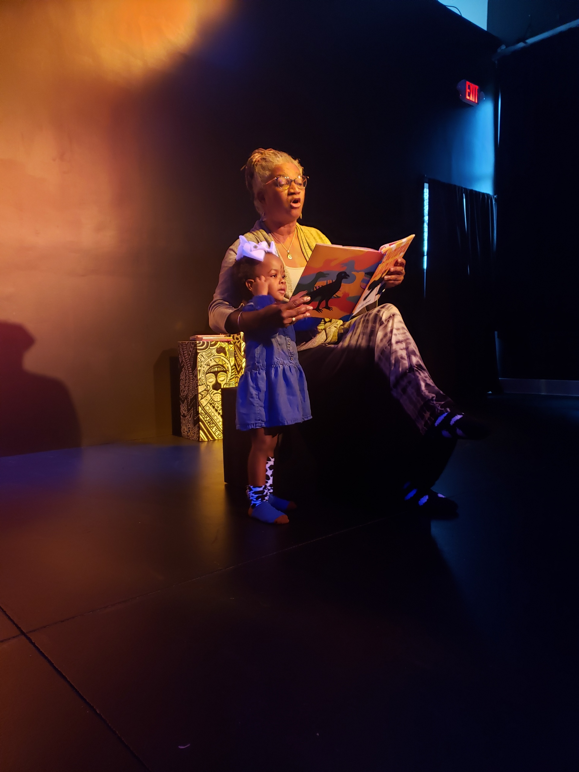 Shirley Thompson reads to toddler