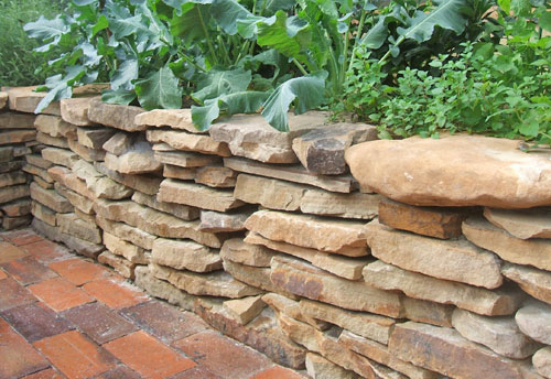 our diy series continues with stone raised garden bed in this exciting clinic you will learn how to build a simple drystack stone wall for your raised