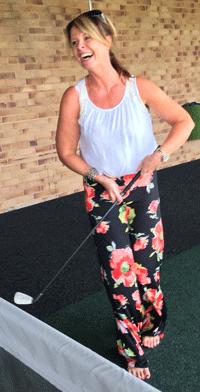 woman enjoying golf