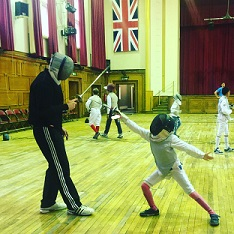 Child learning to Fence