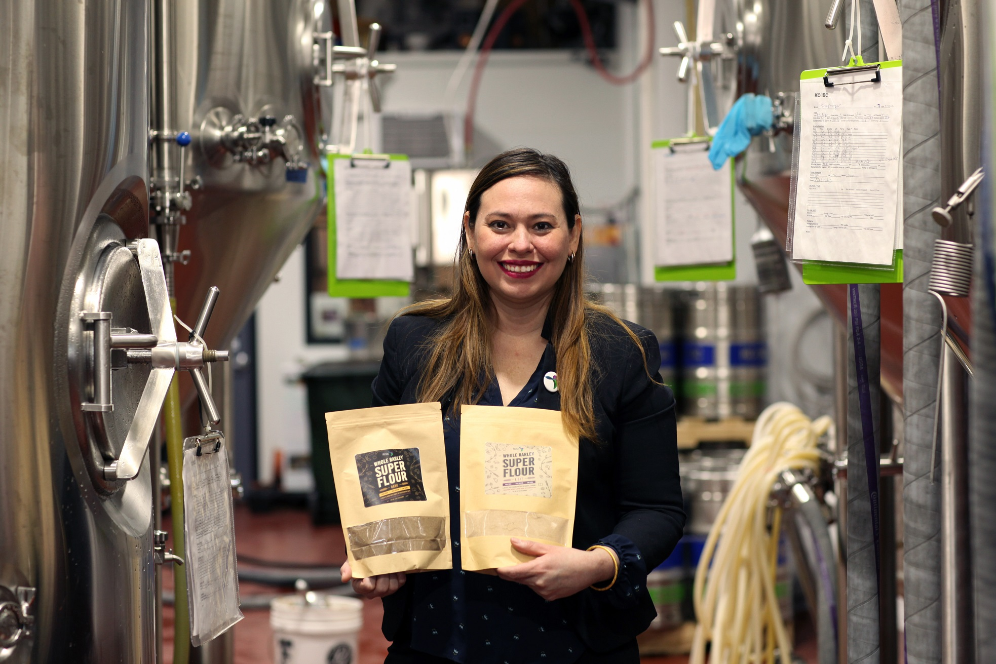 Bertha Jimenez at Kings County Brewers Collective displaying her SUPER FLOUR made with spent grain.