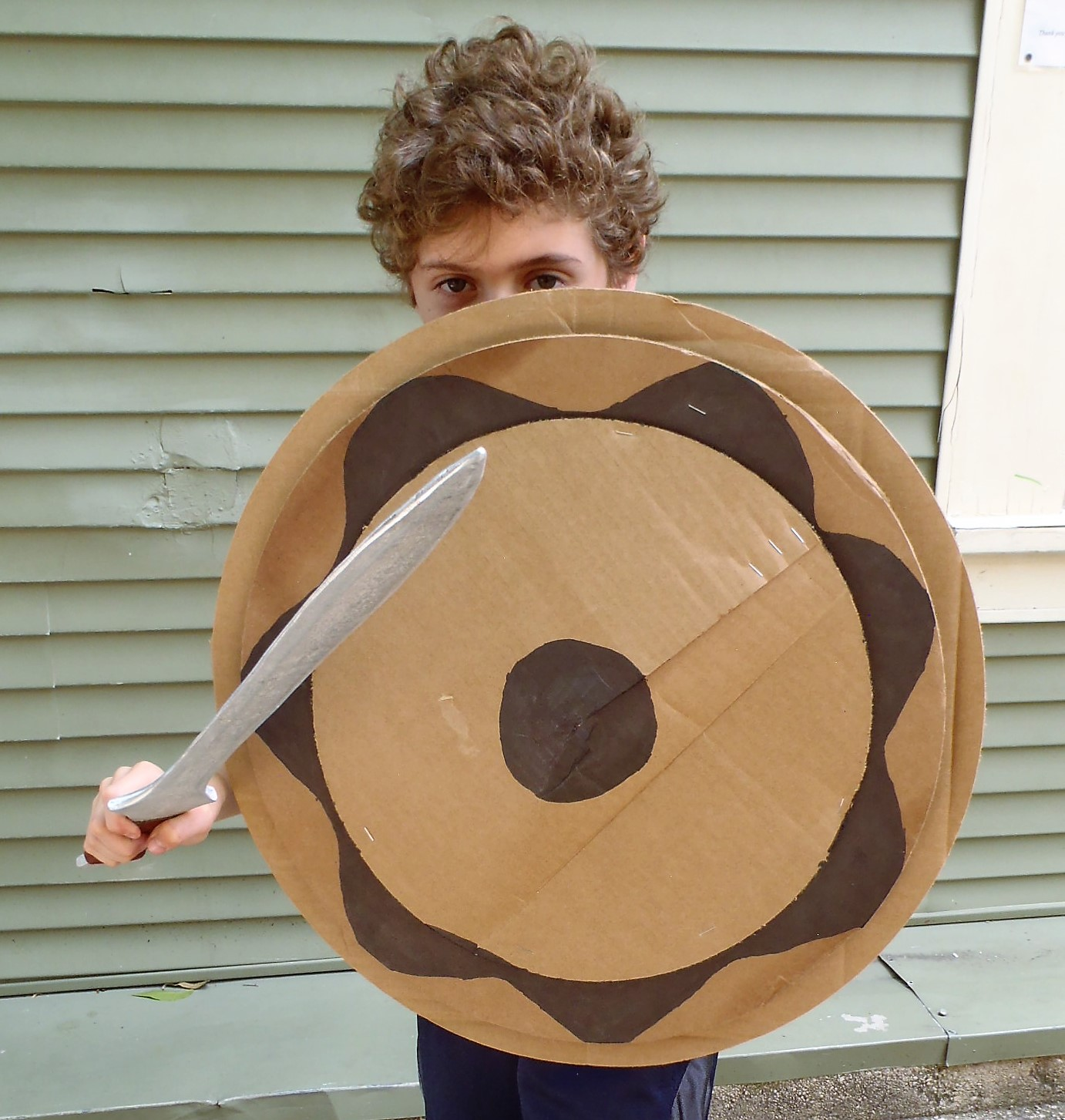 Boy with sword and shield