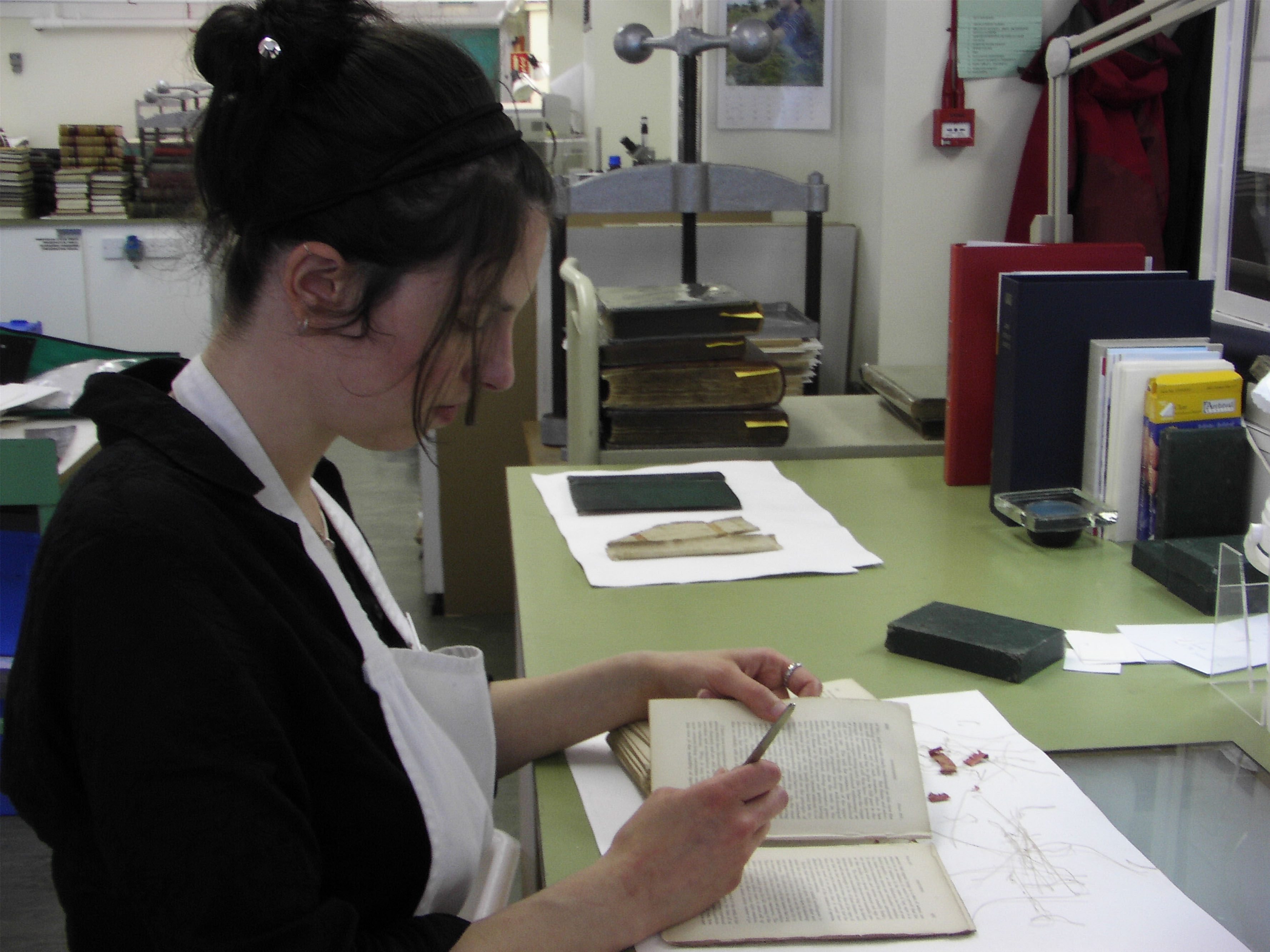 Image of a conservator working on a book